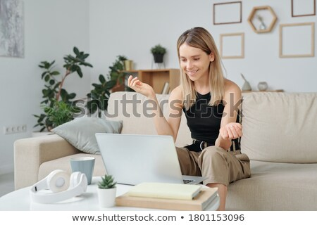 Portrait of smiling brown-haired businesswoman Stock photo © deandrobot