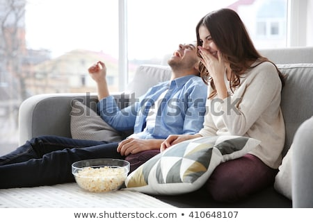 Couple in living room watching television laughing Stock photo © monkey_business