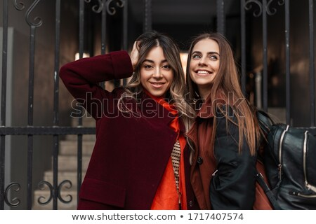 Portrait of a two pretty young girls ironing clothes Stock photo © deandrobot