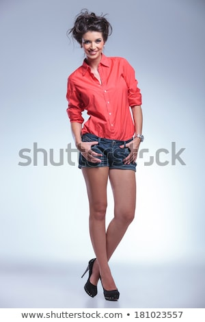 ca8d679d84b Beautiful girl in jeans shorts and a white - red shirt stock photo ...