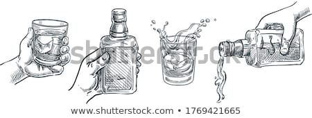 Strong alcohol drink in bottle with shot glass Stock photo © stevanovicigor