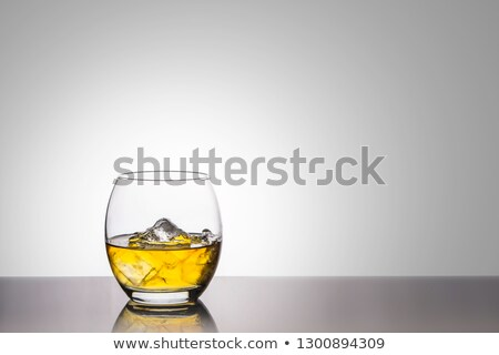 Whiskey and ice. Glass of scotch on rocks. Drink on white backgr Stock photo © popaukropa