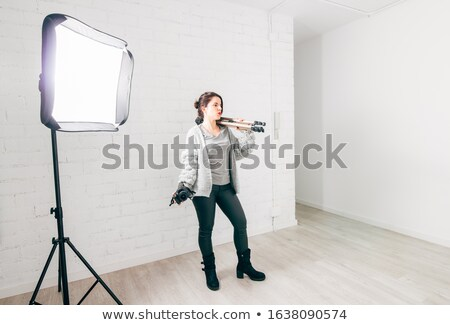 Dslr fotocamera tiro muro di mattoni tecnologia Foto d'archivio © jirkaejc