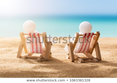 Two Human Figures Relaxing On Deck Chairs Stock photo © AndreyPopov