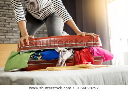 Elbise doldurulmuş bavul yaz seyahat Stok fotoğraf © IS2