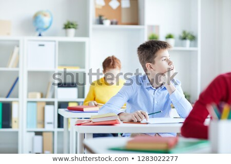 Schoolboy daydreaming in classroom Stock photo © IS2