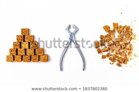 brown sugar cubes and metal sugat tongs stock photo © melnyk