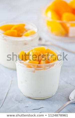 Pareja casero yogurt melocotón orgánico Foto stock © mpessaris