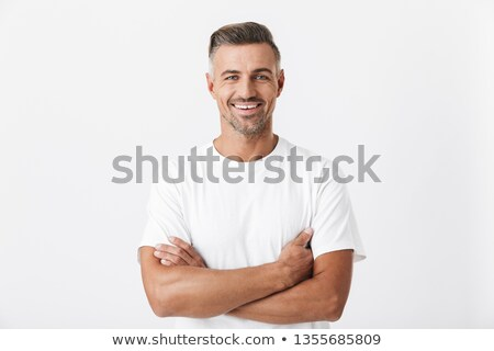 Masculine brunette man 30s with stubble in white shirt looking o Stock photo © deandrobot