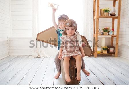 Boldog kicsi fiú pilóta kalap otthon Stock fotó © dolgachov
