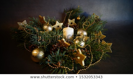 Christmas decor, candles and fir tree branch Stock photo © karandaev