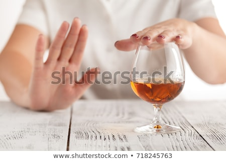 Woman Refusing Glass Of Drink Offered By Person Stock photo © AndreyPopov