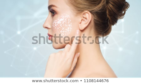 beautiful woman with low poly projection on cheek Stock photo © dolgachov