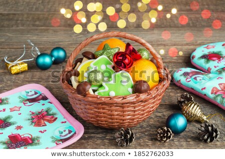 Christmas gingerbread cookies in a round wicker basket Stock photo © madeleine_steinbach