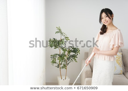 woman cleaning kitchen floor with vacuum cleaner stock photo © andreypopov