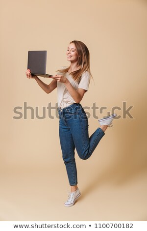 Full length photo of joyous woman 20s wearing casual clothes smi Stock photo © deandrobot