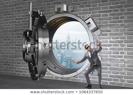 Blindfolded businessman in front ot vault door Stock photo © Elnur