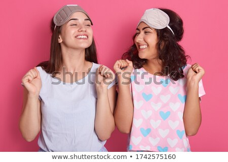 Two excited girls wearing pajamas standing Stock photo © deandrobot