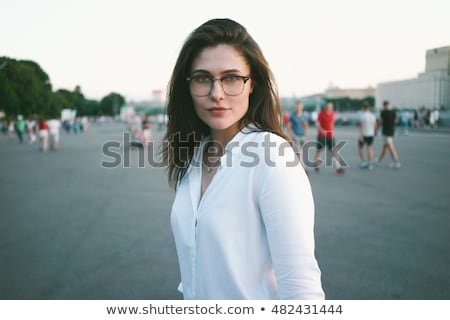 Waist up portrait of charming brown-haired with professional delicate makeup. Attractive female posi Stock photo © studiolucky