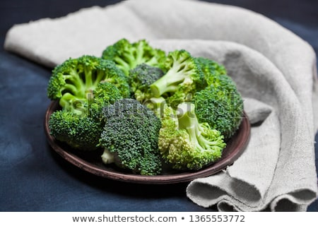 Fresh green organic broccoli in brown plate and linen napkin  Stock photo © marylooo