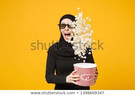 Müslüman kız yeme patlamış mısır örnek arka plan Stok fotoğraf © colematt