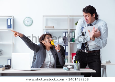 old female boss and young male employee in the office stock photo © elnur
