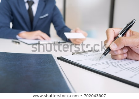 interviewer or board reading a resume during a job interview em stock photo © freedomz