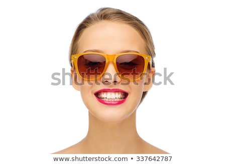 Cosmetics, makeup and trends. Bright lip gloss and lipstick on lips. Closeup of beautiful female fac Stock photo © serdechny