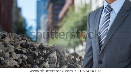 Pile of rubble stone with businessman in city Stock photo © wavebreak_media