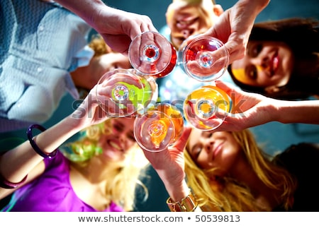 group of people touch champagne glasses and cocktails Stock photo © ruslanshramko