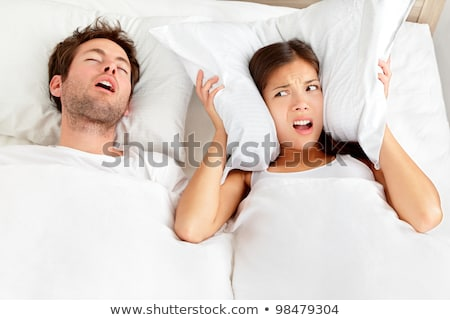 unhappy woman in bed with snoring sleeping man Stock photo © dolgachov