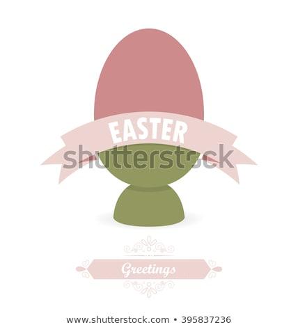 pink easter eggs in holders on white background Stock photo © dolgachov
