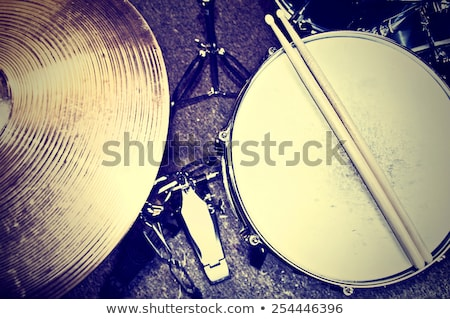 Drums conceptual image. Picture of drums and drumsticks lying on snare drum. Retro vintage picture stock photo © galitskaya