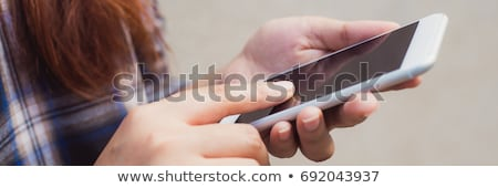 Személy kezek mobiltelefon napló közelkép üzletember Stock fotó © AndreyPopov