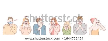 unhealthy young man coughing Stock photo © dolgachov
