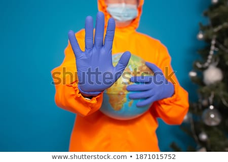doctor man showing a globe with a mask stock photo © nito
