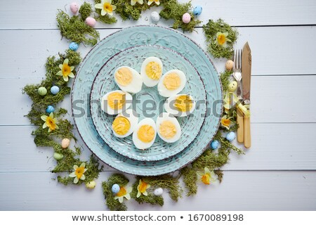 Easter table setting with flowers and eggs. Empty decorative ceramic plates Stock photo © dash