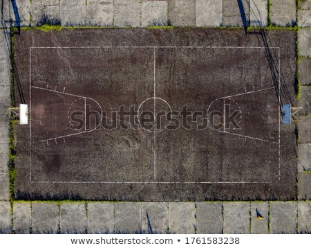 Empty abandoned outdoor basketball court Stock photo © Giulio_Fornasar