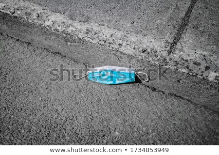 used surgical mask thrown on the asphalt Stock photo © nito
