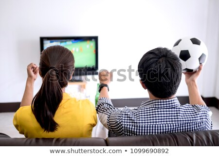 Fiatal ázsiai pár szeretet néz futball Stock fotó © Freedomz