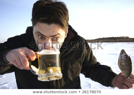 Goblet beer and dried fish stock photo © RuslanOmega