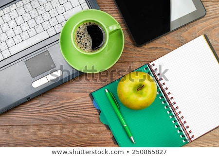 Stock photo: desk with laptop and green apple