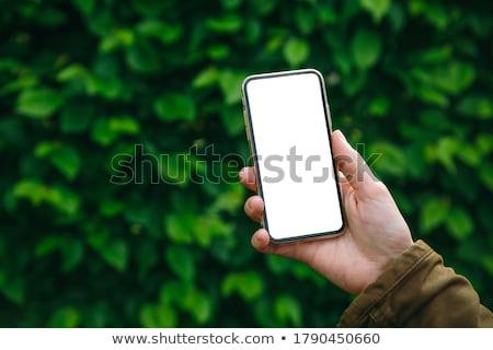 Verde eco teléfono solar blanco resumen Foto stock © -Baks-
