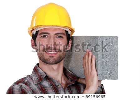 Mason carrying a brick on his shoulder Stock photo © photography33