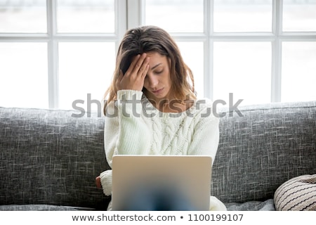Distressed woman with laptop Stock photo © photography33