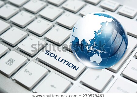 glass globe over keyboard stock photo © yoshiyayo