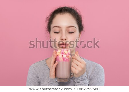 Blue-eyed girl drinks a cocoa stock photo © MilosBekic