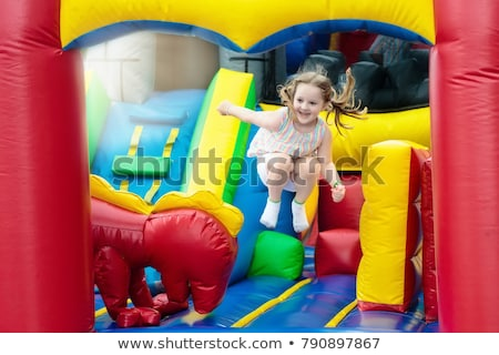 cute little girl on a trampoline Stock photo © kokimk