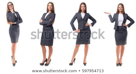 Beautiful young businesswoman standing on white background stock photo © Maridav