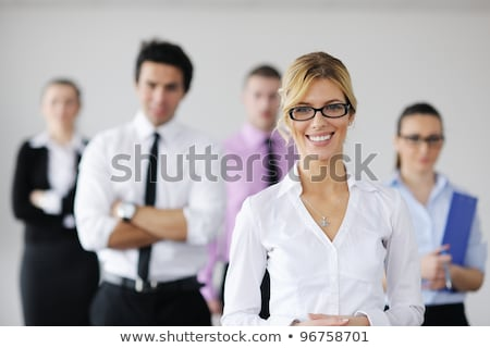 Stock photo: Business Woman Standing With Her Staff In Background